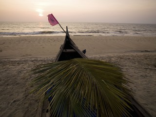 Palm Frond In Boat On Beach, Arabian Sea, Kerala, India