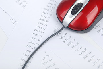 computer mouse with finance charts