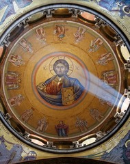 Sunlit painting of Jesus Christ on chirch dome