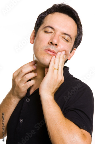 young man in agony with a toothache, isolated on white