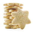 Sugar coated shortbread cookies in star shapes stacked up - on a