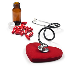 a Doctor's stethoscope listening to a healthy red heart
