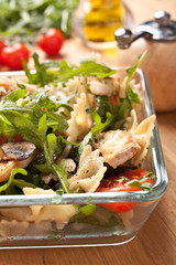 Serving of pasta, turkey, mushroom,rocket and  tomatoes salad