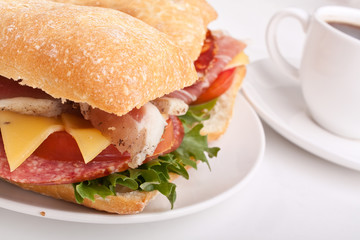 Ciabatta bread sandwich stuffed with meat,cheese and vegetables