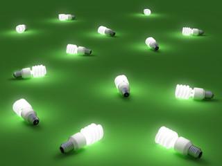 Lampadine fluorescenti accese su un piano verde