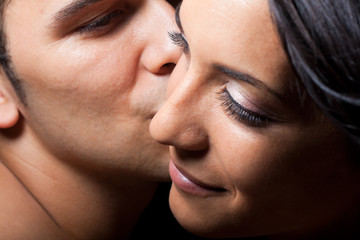 Young couple kissing portrait