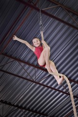 Child Climbing A Rope In Gymnastics