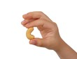 Child's hand holding a cashew