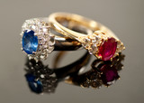 red and blue sapphire rings in diamond settings poster