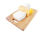 cheeses on wooden board