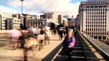 Time-lapse city streets with morning commuters & traffic