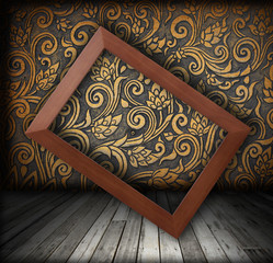 Wood frame on the wall color of golden color shift