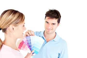 Bright young couple choosing color for a room