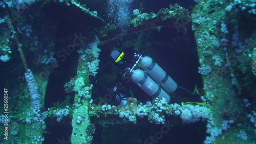 Technical divers exploring shipwreck aida