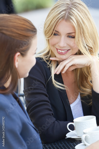 Two Beautiful Young Women Drinking Coffee or Tea