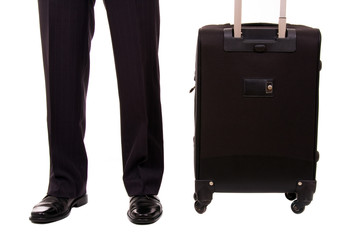 Detail of a businessman with suitcase at the airport