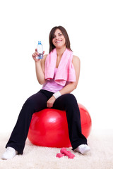 young woman on  red fitness ball