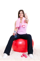 girl sitting on a fitness ball