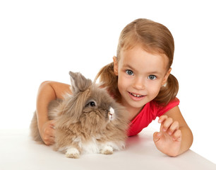 Child with a rabbit.