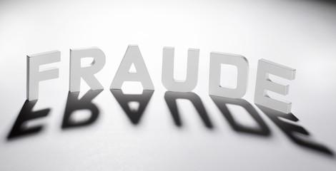 concept mot fraude ombre et lumière