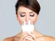 Portrait of beautiful woman, she holdin glass of milk