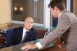 Businessmen conversing at office