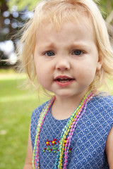 Pretty blond toddler frowning