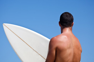 Silhouette of Male Surfer Holding Surf Board