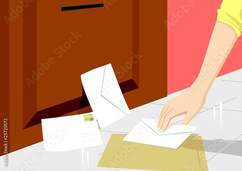 A person picking up letters
