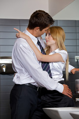 couple flirting with each other at office washroom