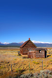 Abandoned ranch in the middle of prairie landscape poster
