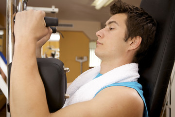 A young man exercising at gym