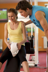 Man and Woman Talking in Health Club
