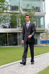 confident caucasian businessman outdoor scene