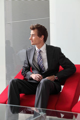 young caucasian businessman sitting in modern office