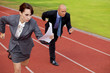 Businessman and woman on running on race track