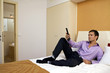 Man on bed with remote control