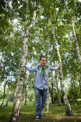 Low angle view of young man standing in park