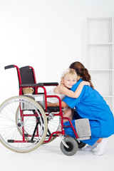little wheelchair patient hugging doctor