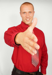Young businessman in red shirt with hanshake