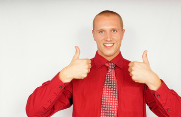 Young businessman in red shirt shows thumbs up