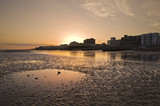 Captivating beautiful sunset over seaside town with reflections poster