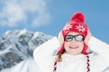 Happy little girl on winter vacation poster