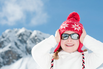 Happy little girl on winter vacation