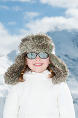 Happy little girl in winter resort