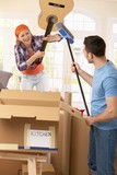 Couple pretending to fight at moving house poster