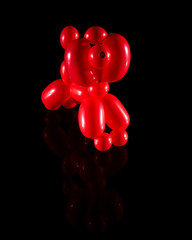 Balloon dog isolated on black with reflection