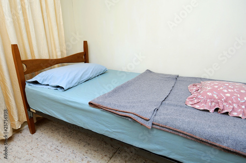 Single bed in motel room
