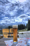 glas of beer and the alps view