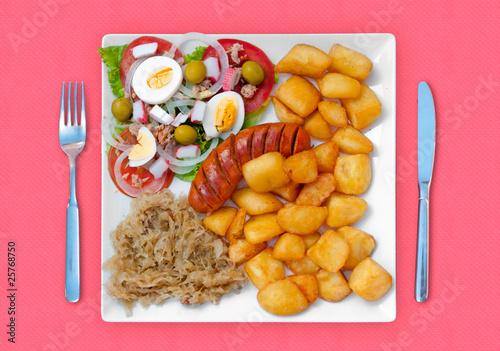 wratwurst with sauerkraut salad and potatoes